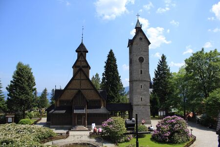 Karpacz, Poland - June 5, 2011: Old church and belfry in polish mountains Stock Photo - 9743911