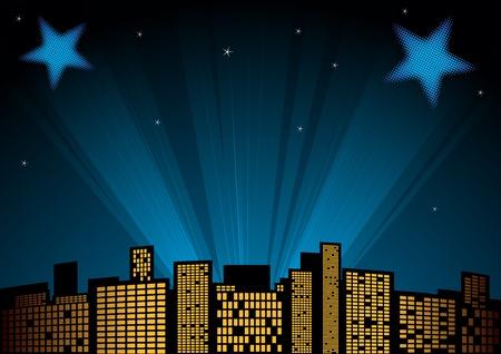 premios: Vista de la ciudad por la noche con focos en segundo plano