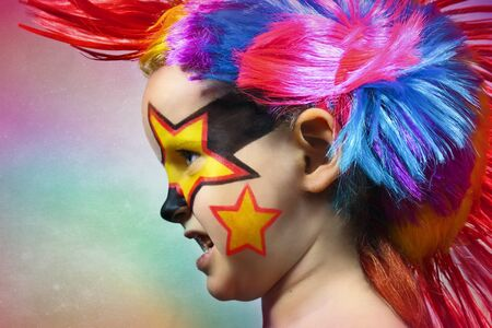 Girl with colorful hair and stars painted on face Stock Photo - 12913523
