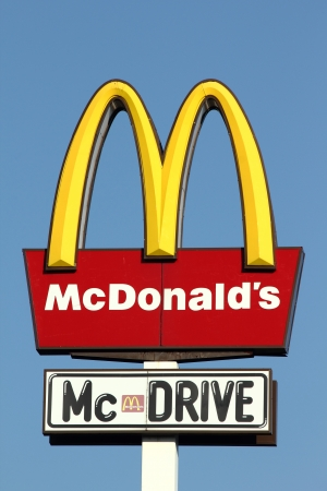 mc: Famous big sign of McDonalds and McDrive Editorial