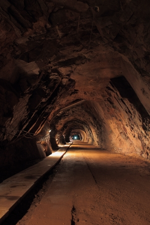 abyss: Long and dark tunnel in old uranium mine Stock Photo