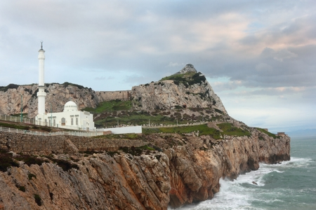 Landscape of shore with Mosque and famous The rock of Gibraltar