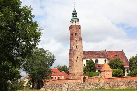 Church behind defence city wall with tower in Wschowa Poland Zdjęcie Seryjne