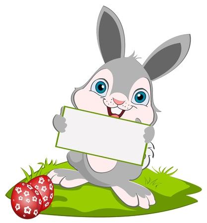 Lapin de Pâques tenant carte de voeux et souriant.