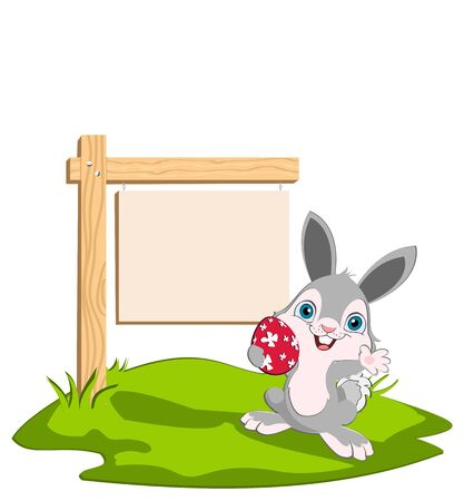 Easter bunny holding a red egg width a wooden sing in the background