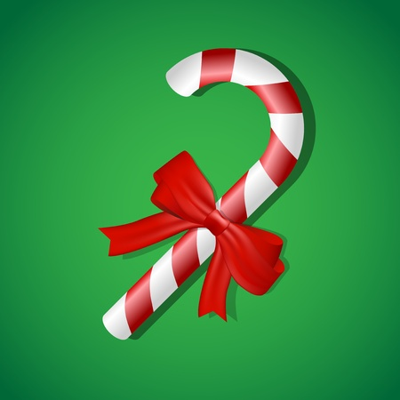 Christmas candy on green background
