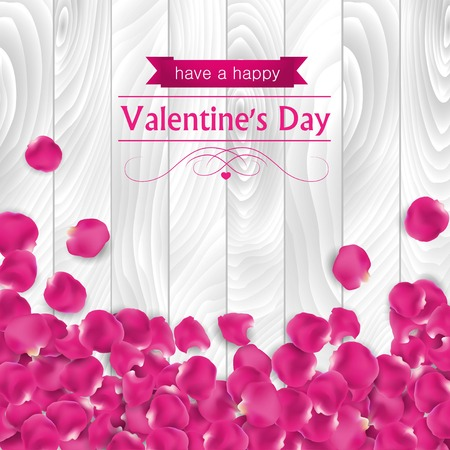 Valentines day card with rose pink petal on a white wooden background.