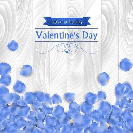 Valentijnsdag kaart met roze blauwe bloemblaadje op een witte houten achtergrond.