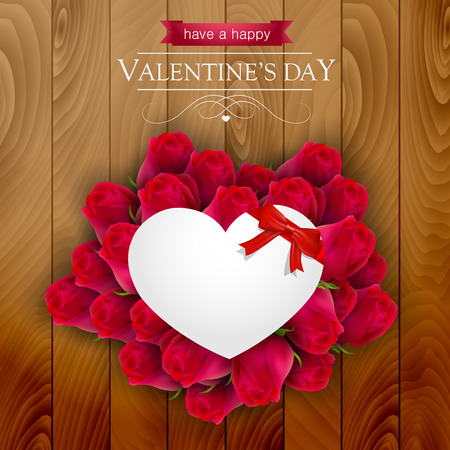 s day: Red roses around a paper heart on a wooden background, Valentines day card.