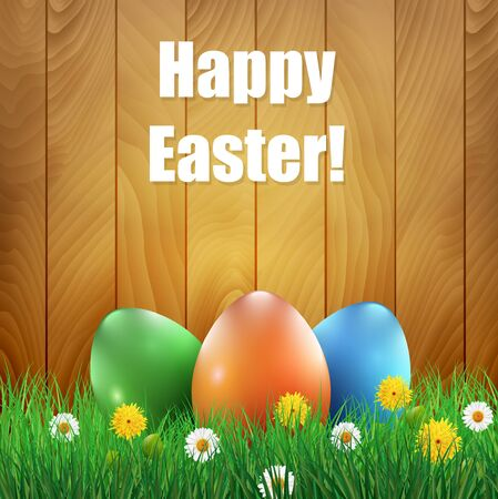 ester: Easter eggs and grass with a wooden background. Ester greeting card.