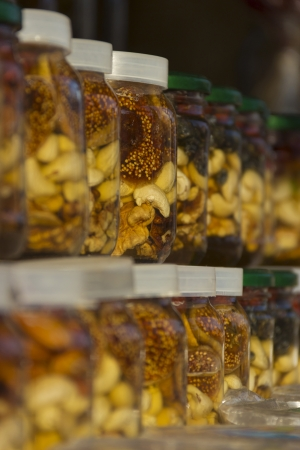 Honey with dried fruit in banks Stock Photo - 15091417