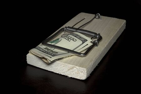 The money trapped on the black background Stock Photo - 15303564