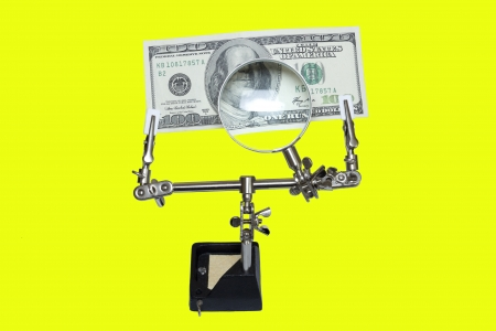 thoroughly: The money secured in the magnifying glass