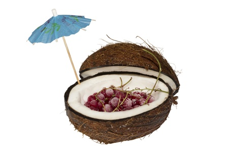 Red currant is in coconut with an umbrella
