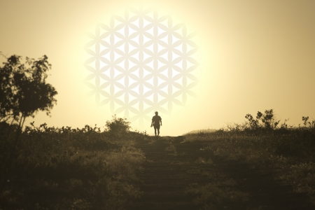 The man comes from the setting sun in the form of flower of life Stock Photo - 18597277