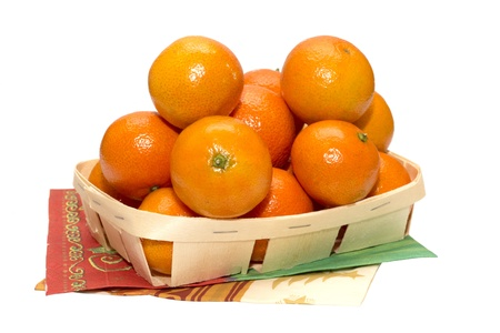 Christmas tangerines on white background in the wooden basket photo