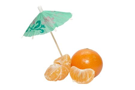 Tangerines and mandarin cloves with the umbrella on white background