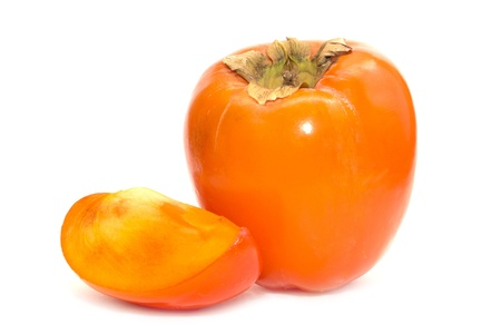 Persimmon whole and slice on white background Stock Photo