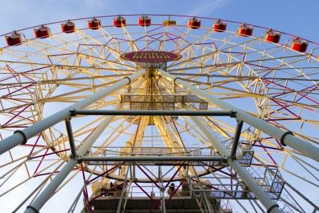 Ferris wheel on the blue bright sky