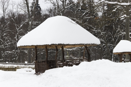Snow-covered pergola in the beautiful winter forest
