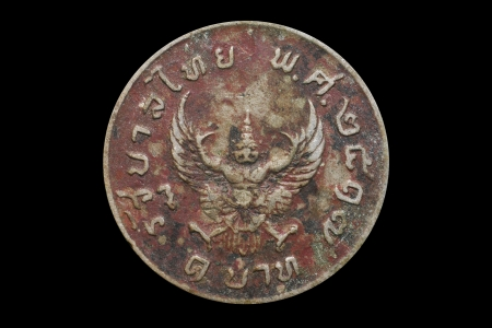 Old coin in Thailand 1974 on black background Stock Photo - 20890337