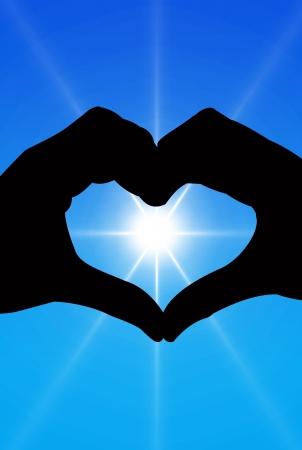 love shape hand silhouette in bule sky