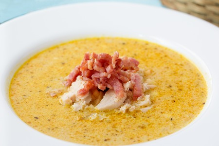 potage: Indian soup Potage Mulligatawny with curry and bacon in white soup bowl Stock Photo