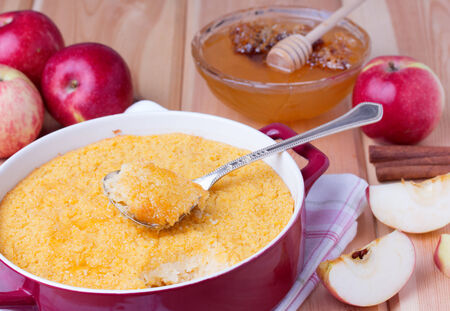 couscous casserole kodafa with apples, honey and cinnamon on wooden background photo