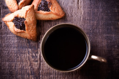 hamantaschen: Hamantaschen cookies for Purim and coffee in ancient cup