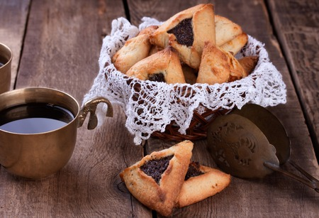 hamantash: Hamantaschen cookies for Purim and coffee in ancient cup