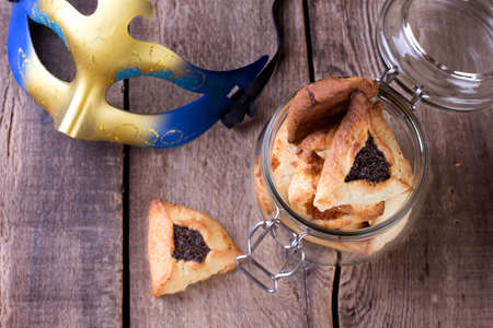 oznei: Hamantaschen cookies for Purim festival with carnival mask