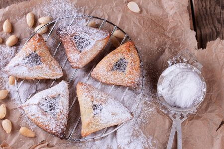 oznei: Hamantaschen cookies for Purim with sugar powder