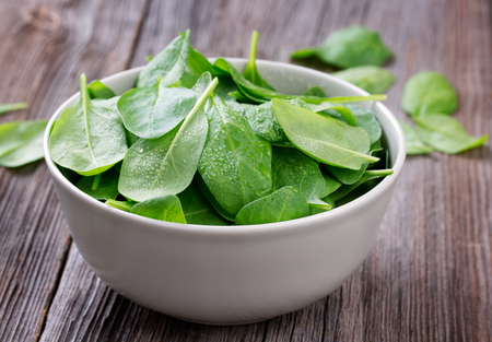 fresh spinach: Fresh spinach in bowl Stock Photo