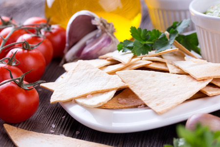 tex mex: Mexican nachos with handmade guacamole sauce on wooden table
