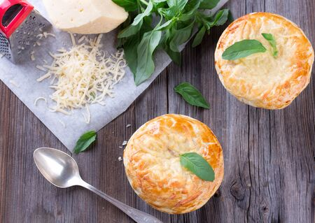 Chicken pot pie with cheese and basil photo