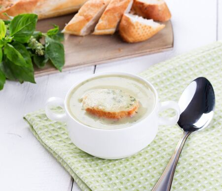 crouton: Vegetable cream soup in white bowl with crouton