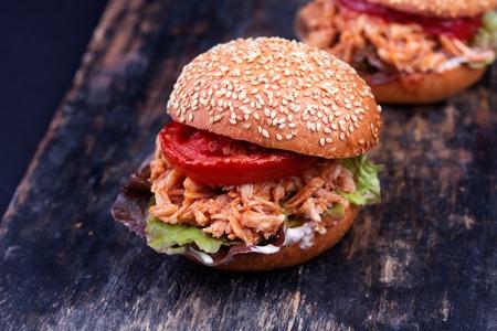 sloppy: Freshly prepared sloppy joe sandwich on rustic black bakery peel.