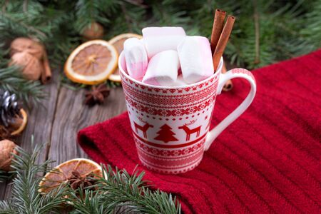scandinavian christmas: Mug of hot chocolate with marshmallows and cinnamon sticks. Christmas or new year still life. Mug is decorated with scandinavian christmas ornaments.