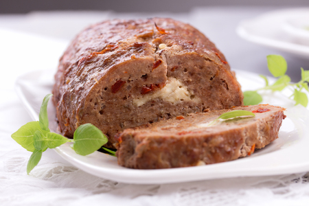meatloaf: sliced homemade meatloaf made from pork and lean ground beef. Stock Photo