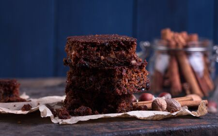 dundee: Pieces of Christmas chocolate cake on wooden background