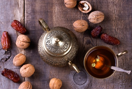Traditional arabic tea set, walnut and dried dates.