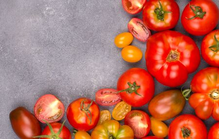 halved  half: Fresh tomatoes in the foreground with copyspace Stock Photo