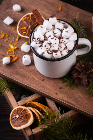 Christmas decoration. Enamel cup of hot chocolate with marshmallows on a wooden table Stock fotó