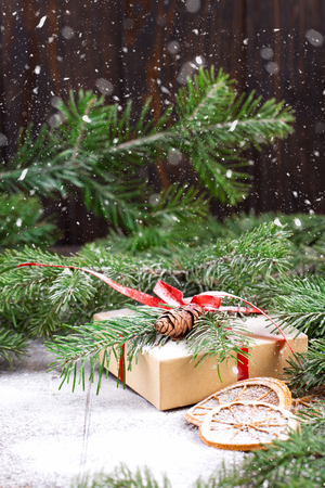 Christmas gift box. Christmas presents in boxes wrapped in craft paper at white wooden table. Stock fotó