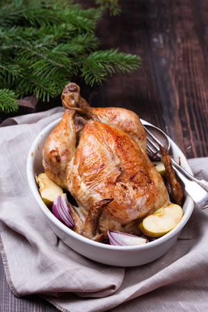 Christmas roast chicken served on a festive table. Old wooden table. Stock fotó