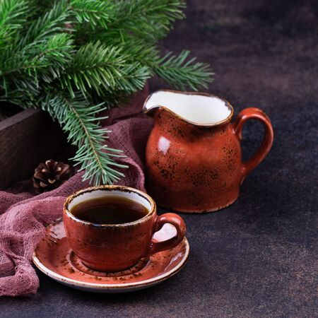Cup of coffee with christmas tree on a table.