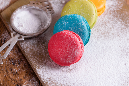 Colorful macarons on wooden desk. Stock fotó