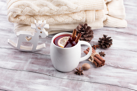 Christmas mulled wine on a rustic wooden table. Stock fotó