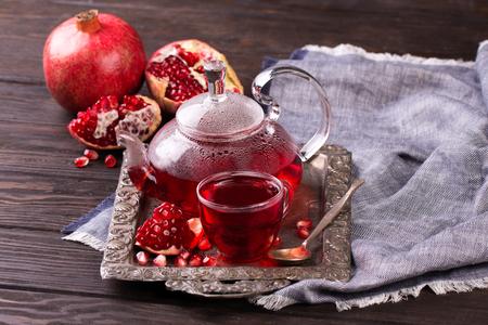 Fruit pomegranate tea in a teapot and cup. Turkish tea. Oriental tea ceremony concept. 스톡 콘텐츠