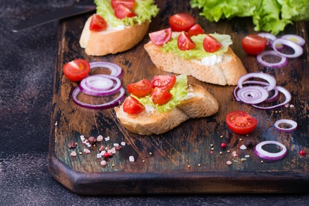 Bruschetta with tomatoes, herbs and oil on toasted garlic bread